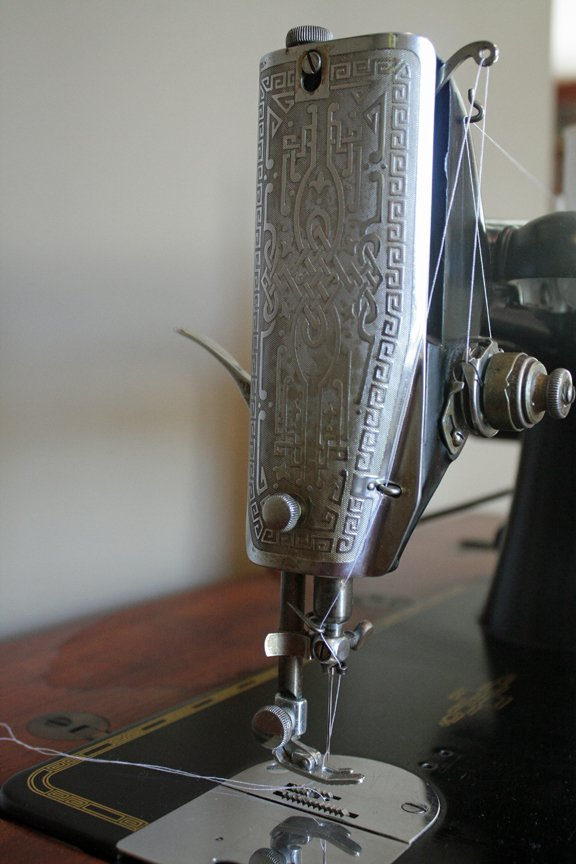 Engraved plate of a vintage Singer sewing machine in need of restoration