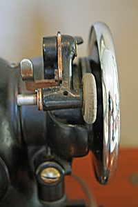 The handwheel of a vintage Singer 201-2