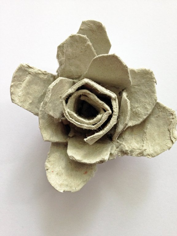 The finished, unpainted rose made from cardboard egg cartons