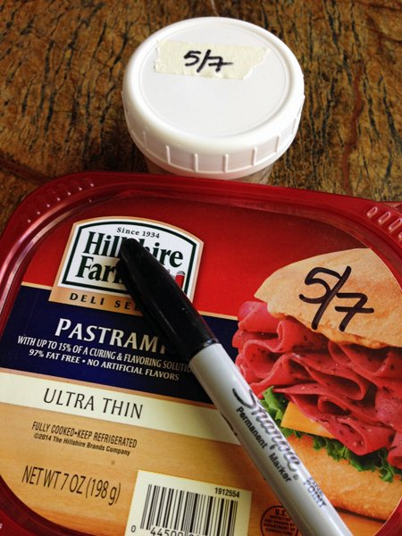 Container of food and marker.