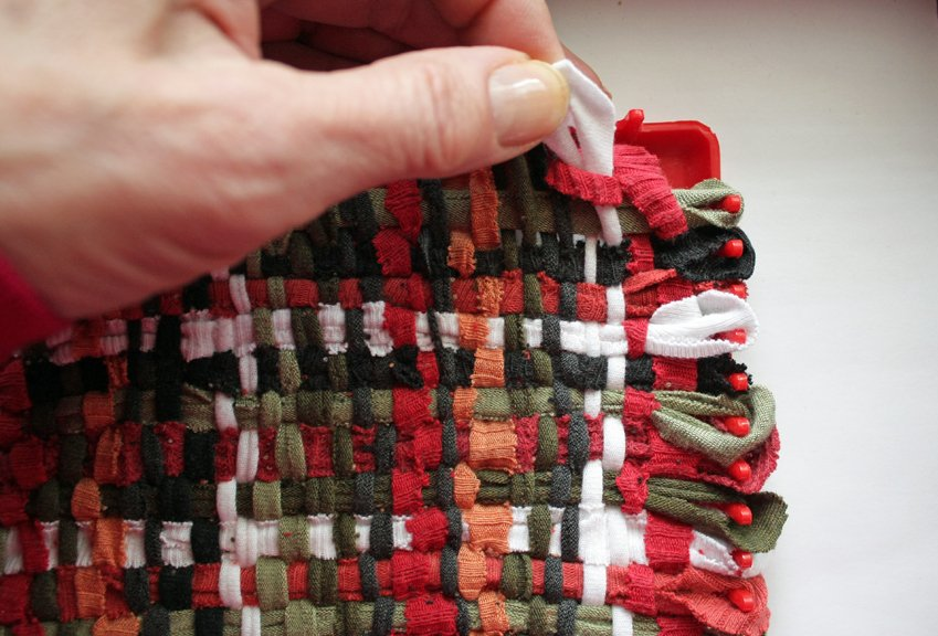 Weaving a potholder using recycled T-shirts