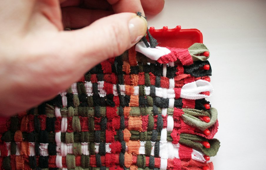 Chaining the ends of the potholder made from recycled T-shirts