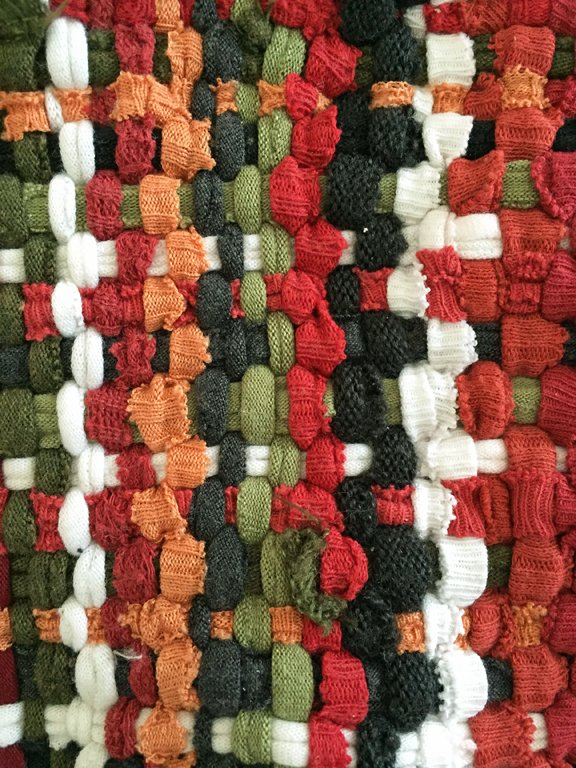 A close-up of the woven potholder loops made from recycled T-shirts