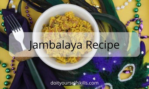 Bowl of jambalaya, Mardi Gras beads and feathered mask
