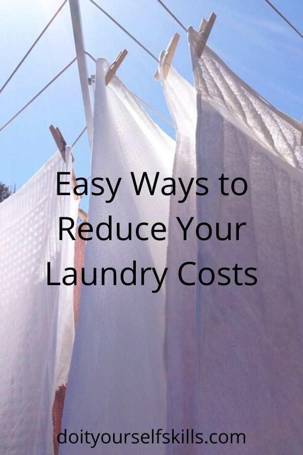 White towels hanging on a clothesline to reduce laundry costs