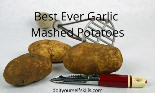 Potatoes with a vintage potato masher and vintage potato peeler for a garlic mashed potato recipe