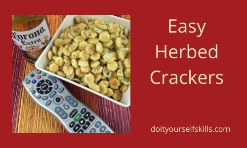 Bowl of homemade herbed crackers and TV remote