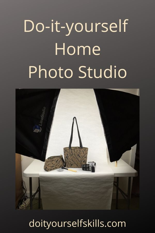 DIY home photography studio with table, soft box lighting and white backdrop