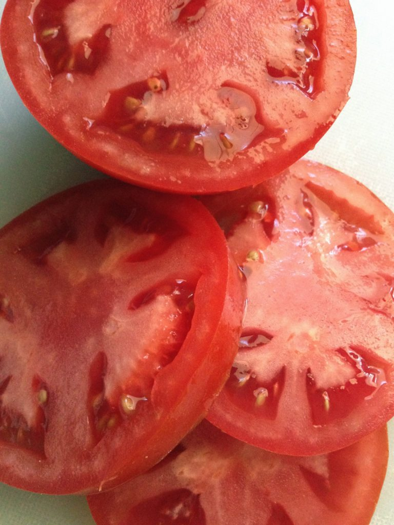 Slices of fresh tomatoes right from the garden
