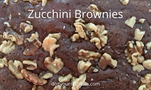 Close up of zucchini brownies with walnuts on top